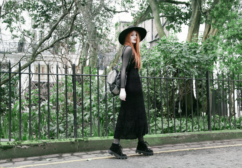 Olivia Emily wears Killstar Witch Brim Hat, Black Milk Burned Velvet Reaper Dress over American Apparel Mesh Long Sleeve Dress, Rebecca Minkoff Studded Backpack, and Underground Shoe Jungle Boots