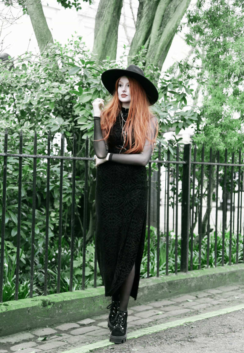 Olivia Emily wears Killstar Witch Brim Hat, Black Milk Burned Velvet Reaper Dress over American Apparel Mesh Long Sleeve Dress, and Underground Shoe Jungle Boots