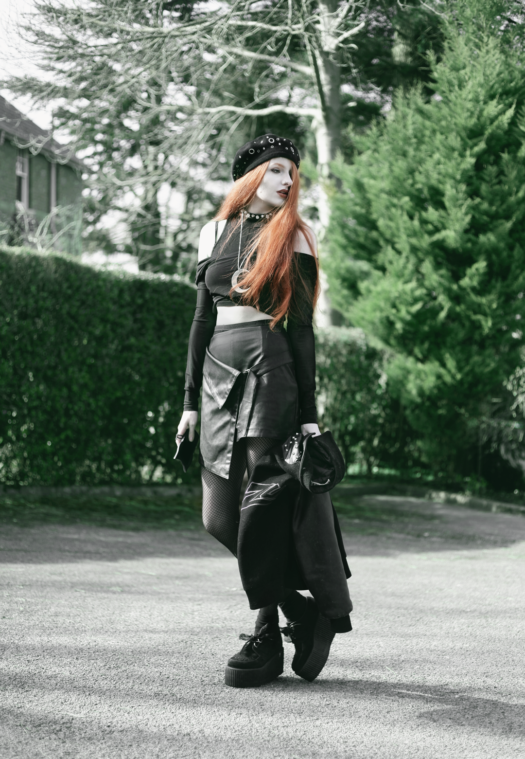 Olivia Emily wears Asos Eyelet beret, Killstar Luna Moon Necklace, Yayer high neck crop top under Asos Tall mesh off the shoulder wrap top, Vintage baseball jacket, asos faux leather wrap skirt & Underground triple sole creepers