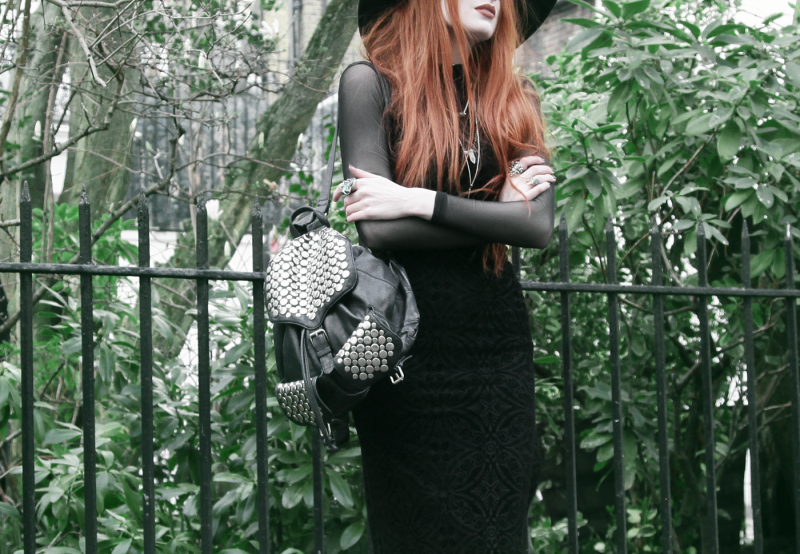 Olivia Emily wears Killstar Witch Brim Hat, Black Milk Burned Velvet Reaper Dress over American Apparel Mesh Long Sleeve Dress, and Rebecca Minkoff Studded Backpack