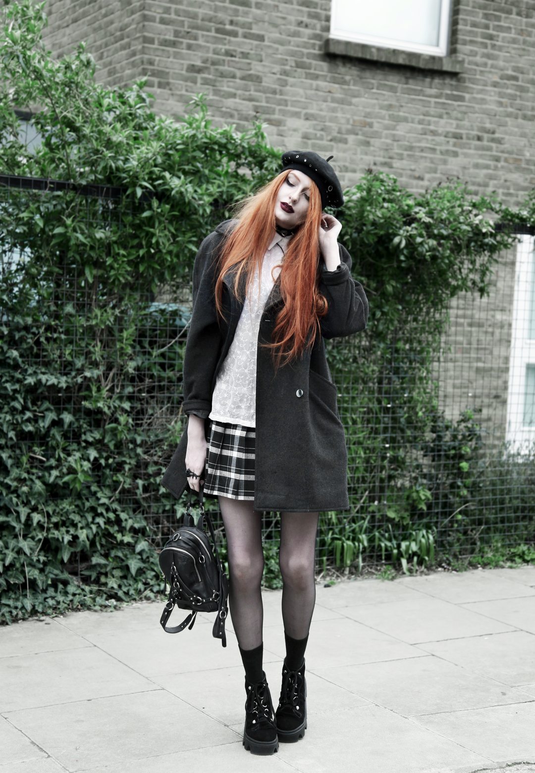 Olivia Emily wears Asos Eyelet Beret, Seconhand Coat & Blouse, Asos x Le Kilt collab plaid skirt, unif bound mini backpack, Underground Jungle Evolution Boots
