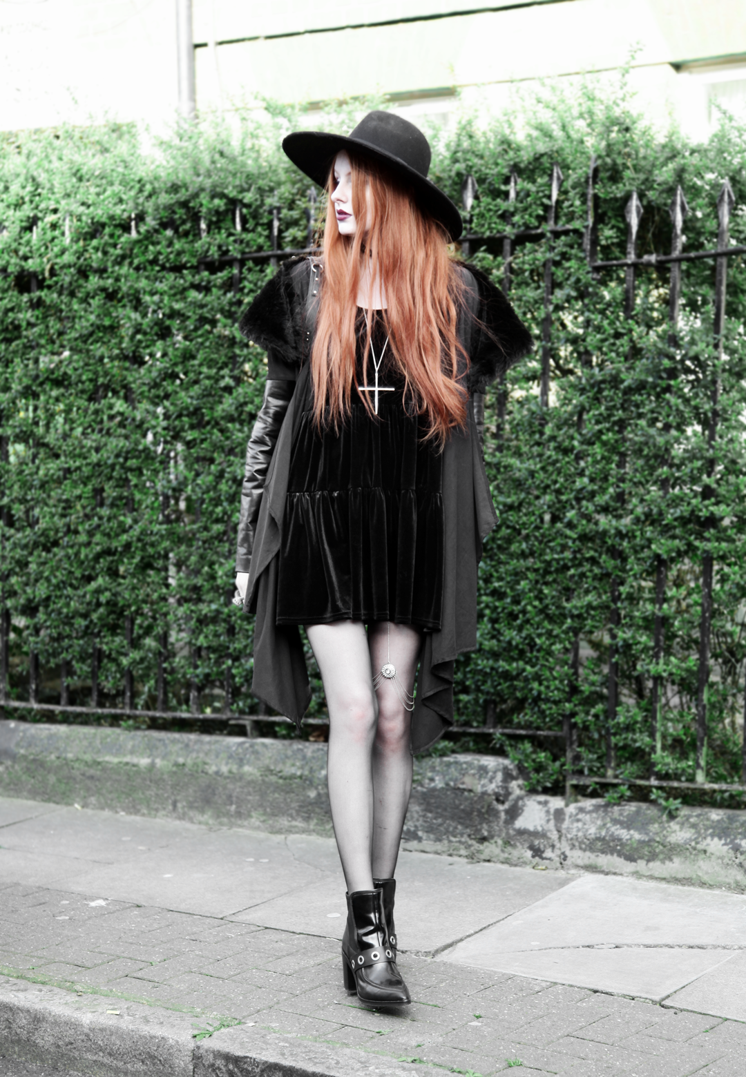 Olivia Emily wears Asos Reclaimed Vintage tiered black velvet dress, Killstar Witch Brim hat, Sanctus Asylum vegan suede coat, River Island leg chain, Asos eyelet boots
