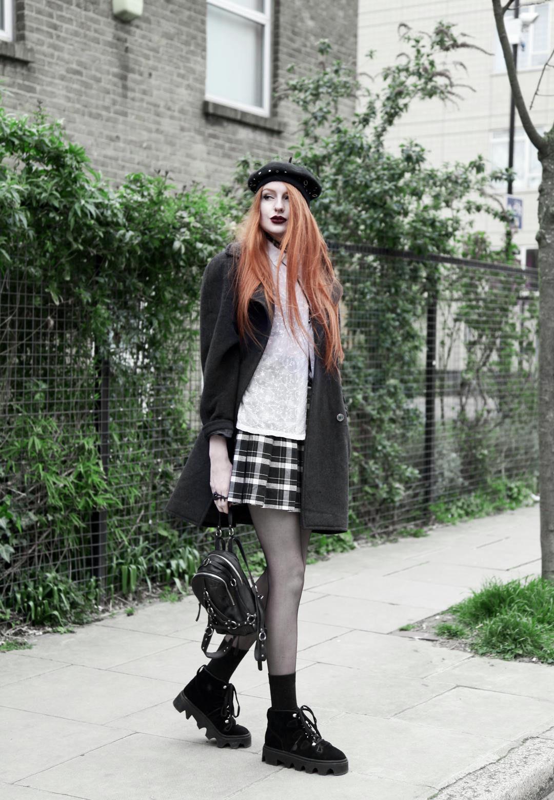 Olivia Emily wears Asos Eyelet Beret, Seconhand Coat & Blouse, Asos x Le Kilt collab plaid skirt, unif bound mini backpack, Underground Jungle Evolution Boots