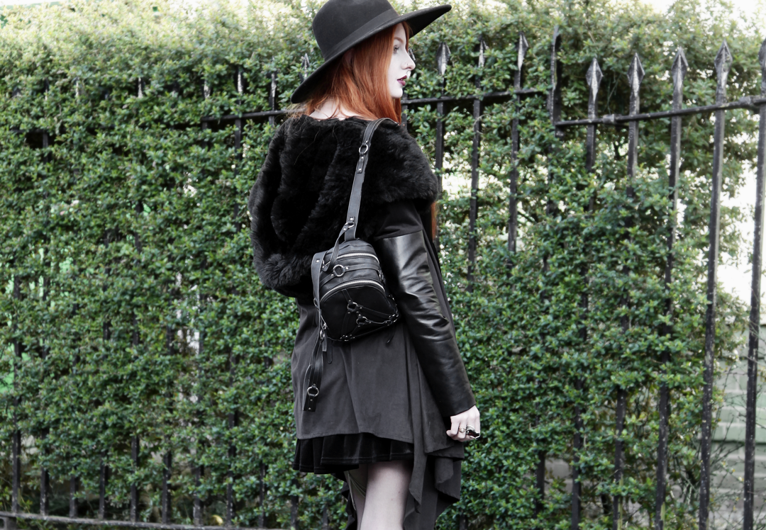 Olivia Emily wears Asos Reclaimed Vintage tiered black velvet dress, Killstar Witch Brim hat, Sanctus Asylum vegan suede coat and Unif Bound Mini backpack