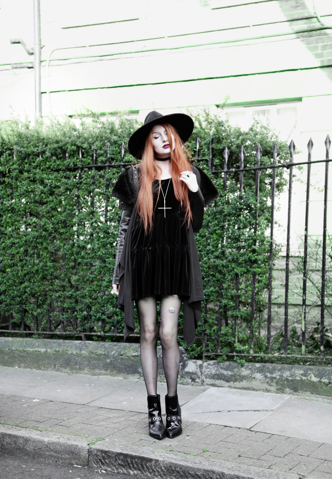 Olivia Emily wears Asos Reclaimed Vintage tiered black velvet dress, Killstar Witch Brim hat, Sanctus Asylum vegan suede coat, River Island leg chain and Asos eyelet boots