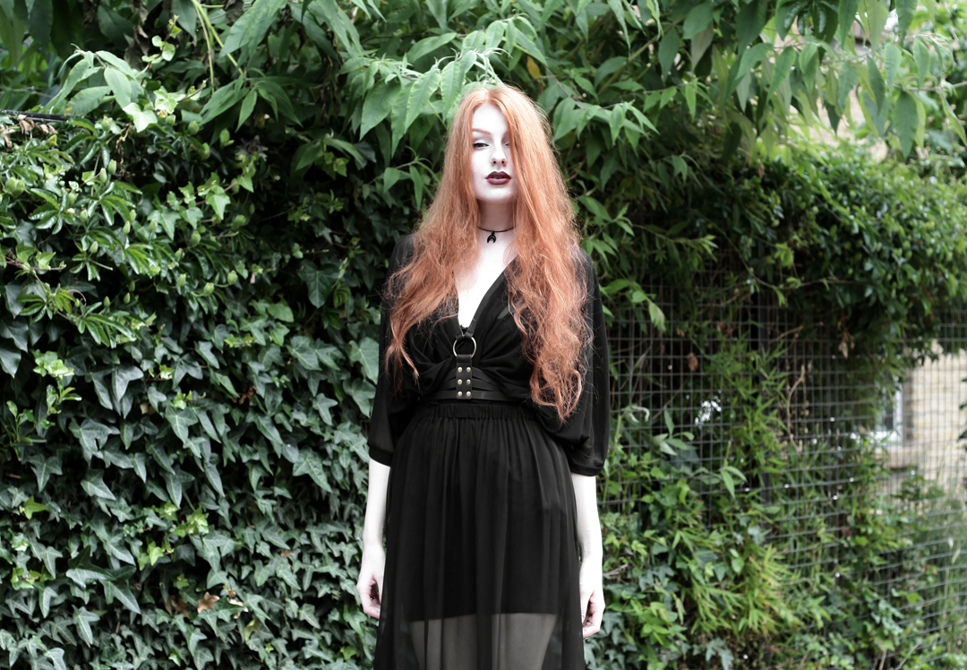 Olivia Emily wears Killstar Mesh Top, Dark Thorn Chastity Sheer Maxi Skirt, Asos Harness and Rogue and Wolf Choker