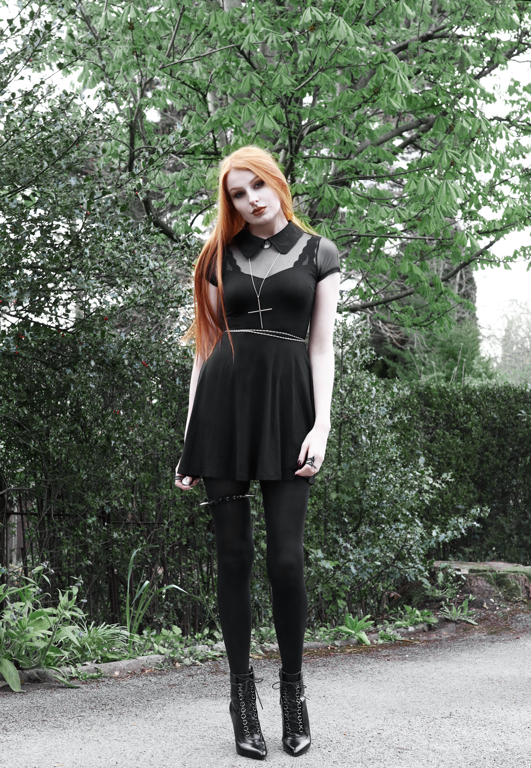 Olivia Emily wears Killstar Dana dress, Kiki Minchin necklace, spiked garter, Saint Laurent Fetish boots YSL SLP