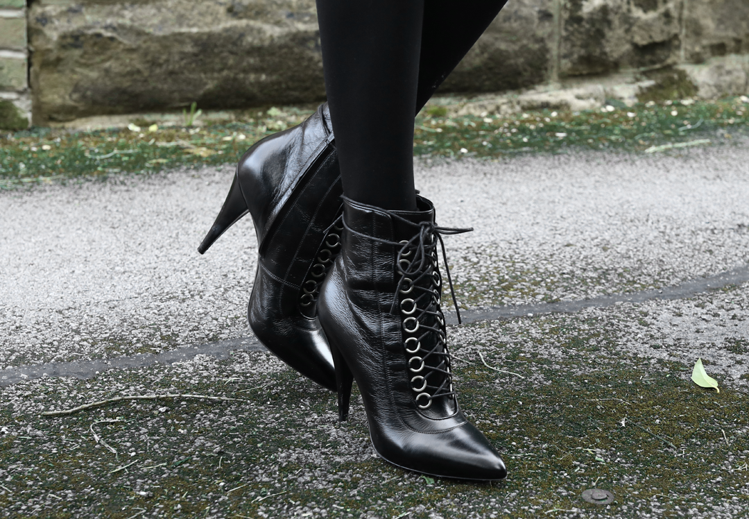 Olivia Emily wears Saint Laurent Fetish Lace Up Ankle Boots