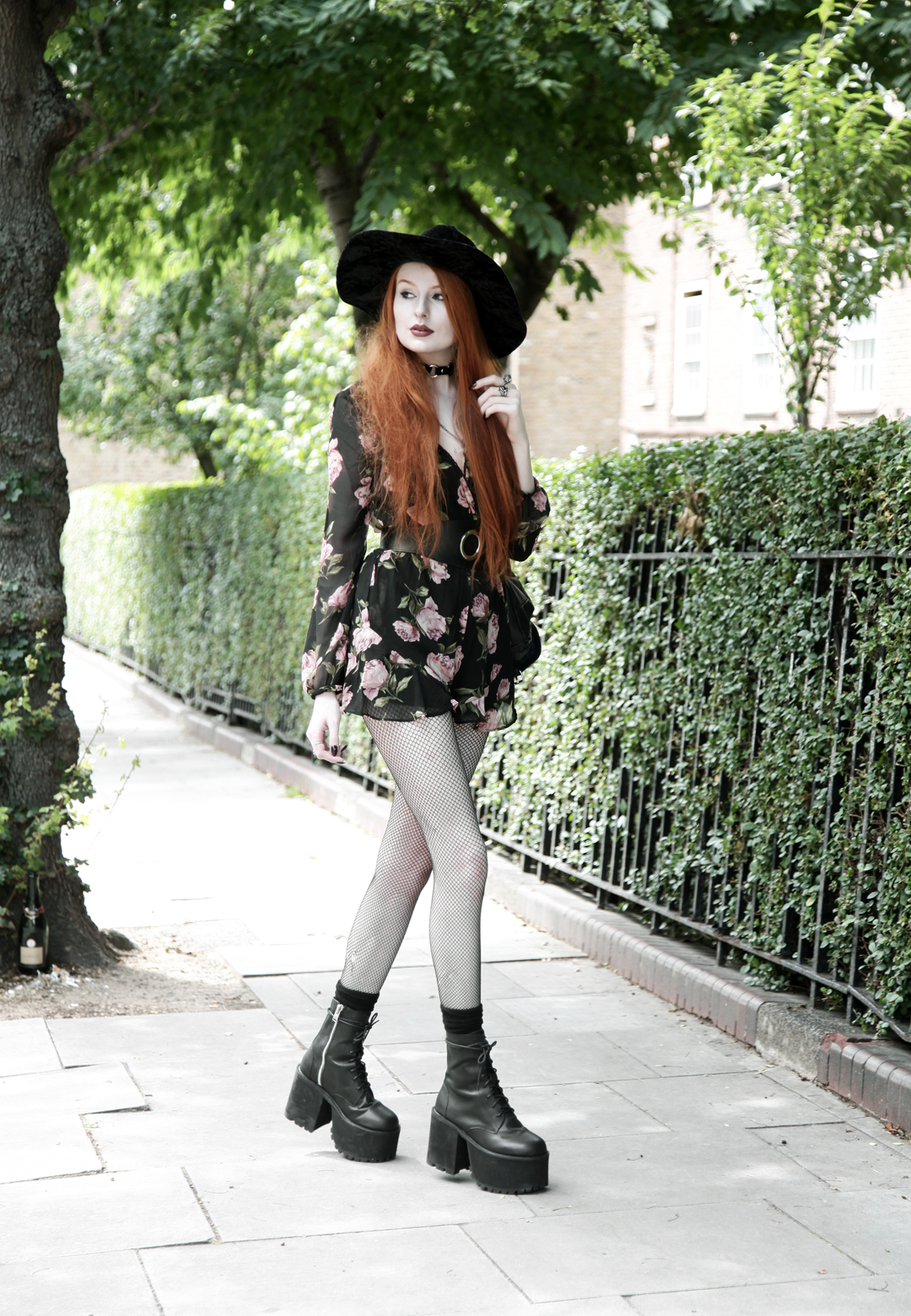 Olivia Emily wears Asos Band Of Gypsies playsuit, Killstar velvet witch brim hat, Zana Bayne Cincher Waist Belt, and Unif Scosche boots