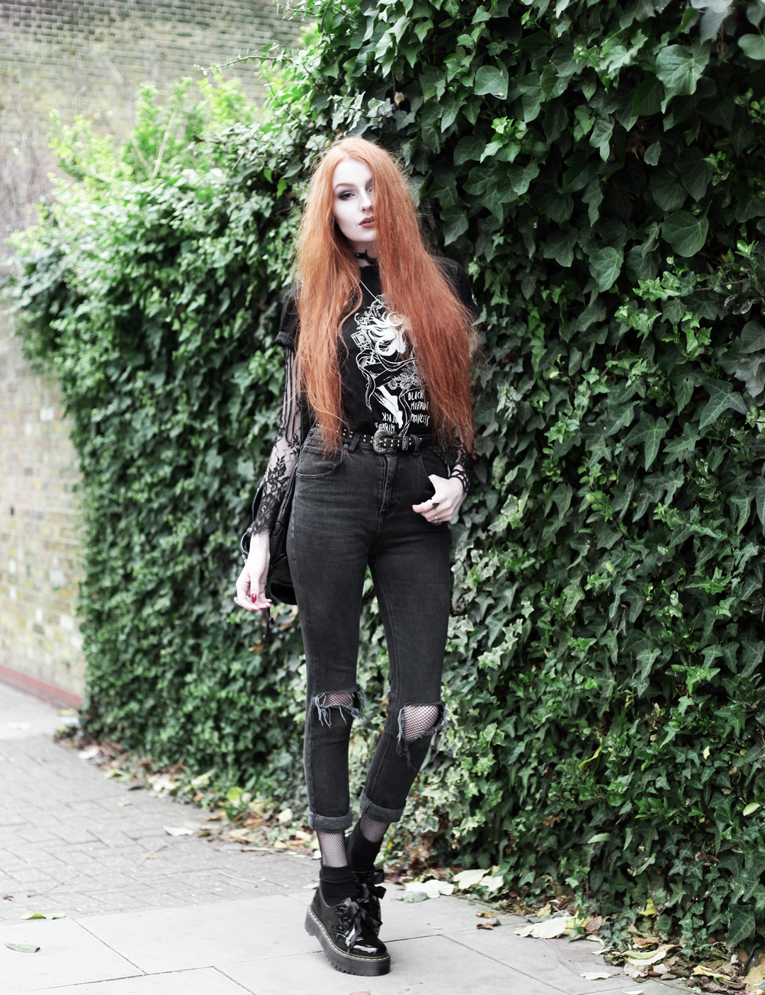 Olivia Emily wears CosQueen Black Mirror Princess Tee, Motel Black Lace Top, Asos Western Belt, Asos High Waisted Ripped Jeans, Dr Martens Patent Holly Shoes