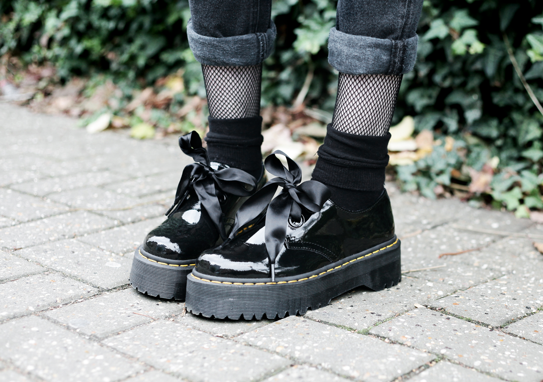 Olivia Emily wears Dr Martens Patent Holly shoes