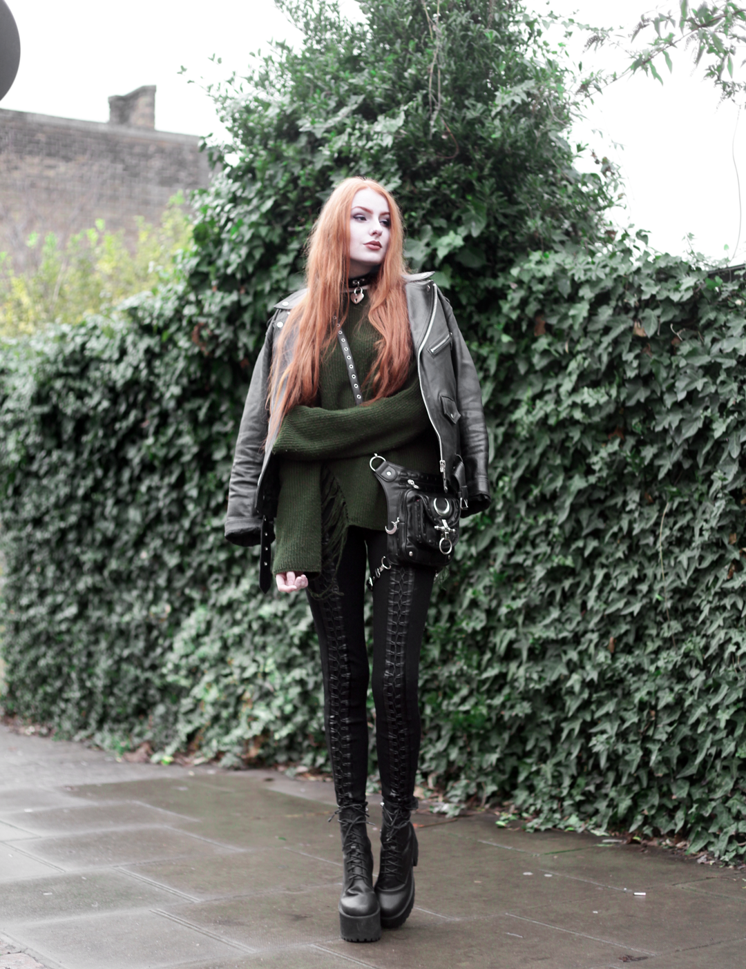 Olivia Emily wears Biker Jacket, Asos Bones Oversized jumper, Restyle pl harness bag, Stylestalker lace up leggings trousers, Unif scosche boots