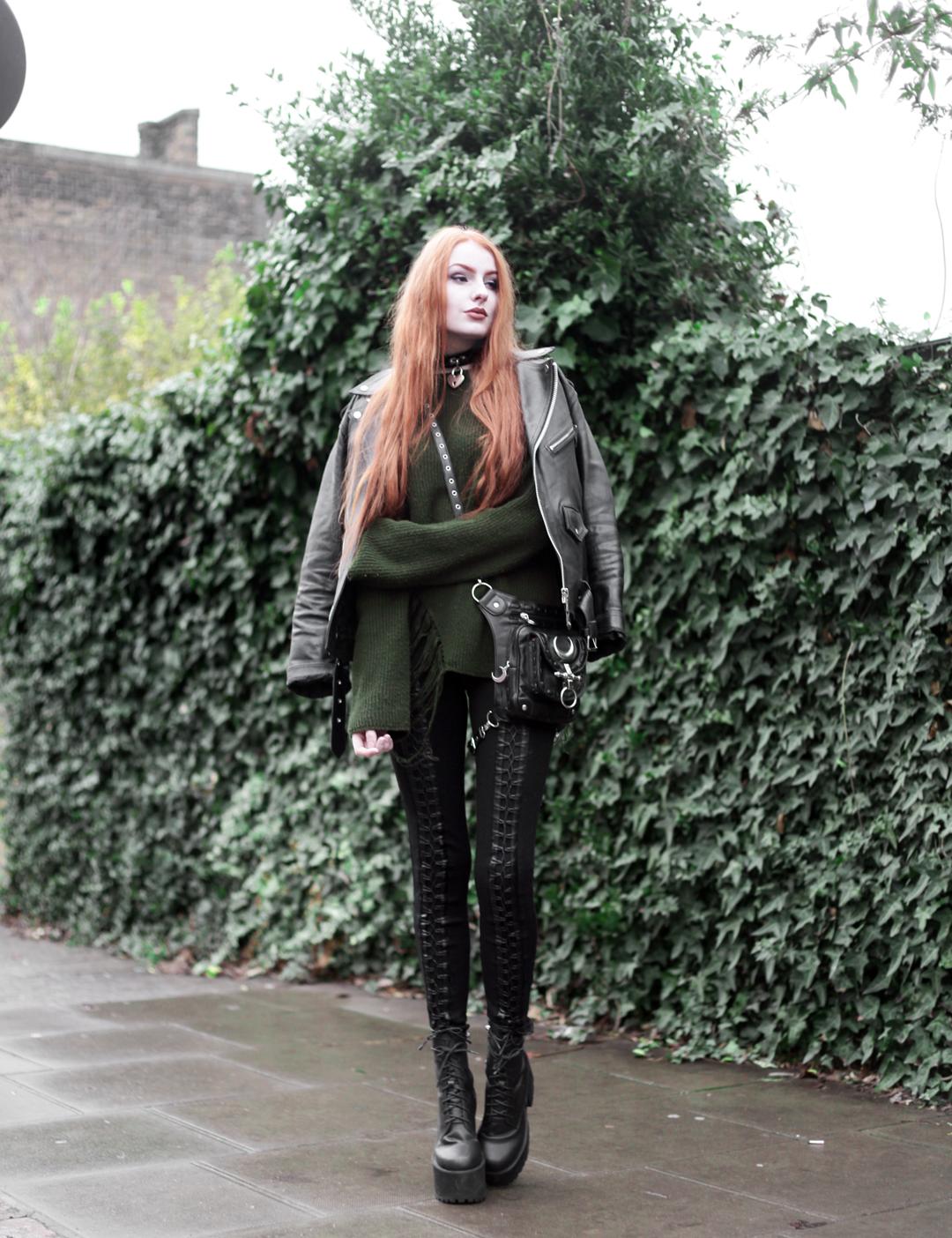 Olivia Emily wears Biker Jacket, Asos Bones Oversized jumper, Restyle pl harness bag, Stylestalker lace up leggings trousers, Unif scosche boots