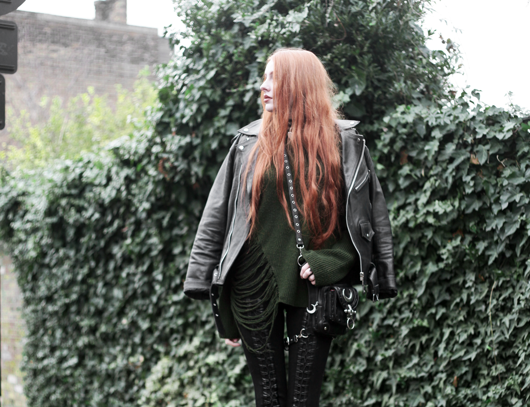 Olivia Emily wears Biker Jacket, Asos Bones Oversized jumper, Restyle pl harness bag, and Stylestalker lace up leggings trousers
