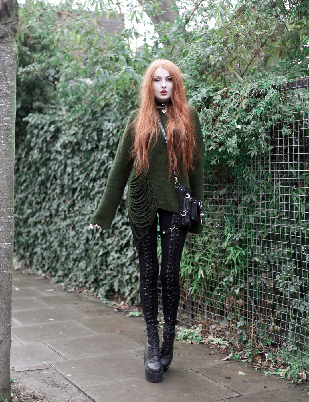 Olivia Emily wears Asos Bones Oversized jumper, Restyle pl harness bag, Stylestalker lace up leggings trousers, and Unif scosche boots