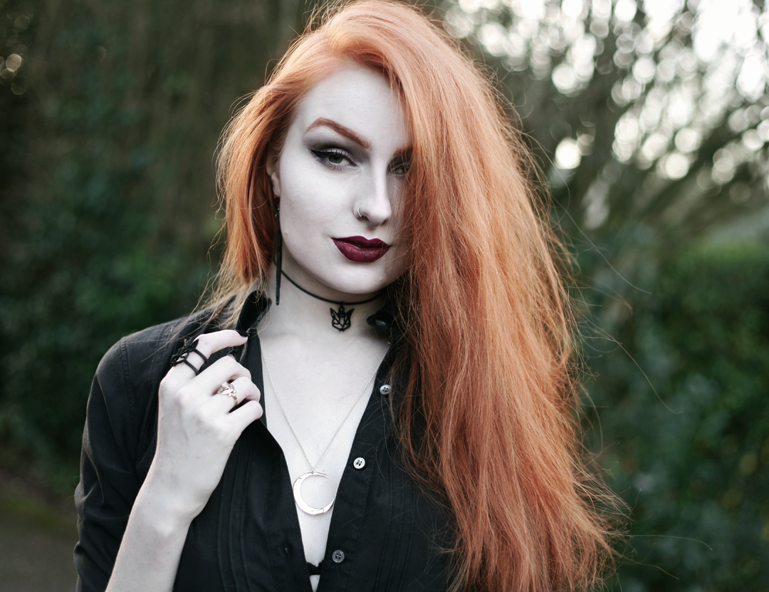 Olivia Emily wears Black Shirt, Avalanche Jewellery Mega Lune Necklace and Rogue and Wolf Cat Choker & Earrings