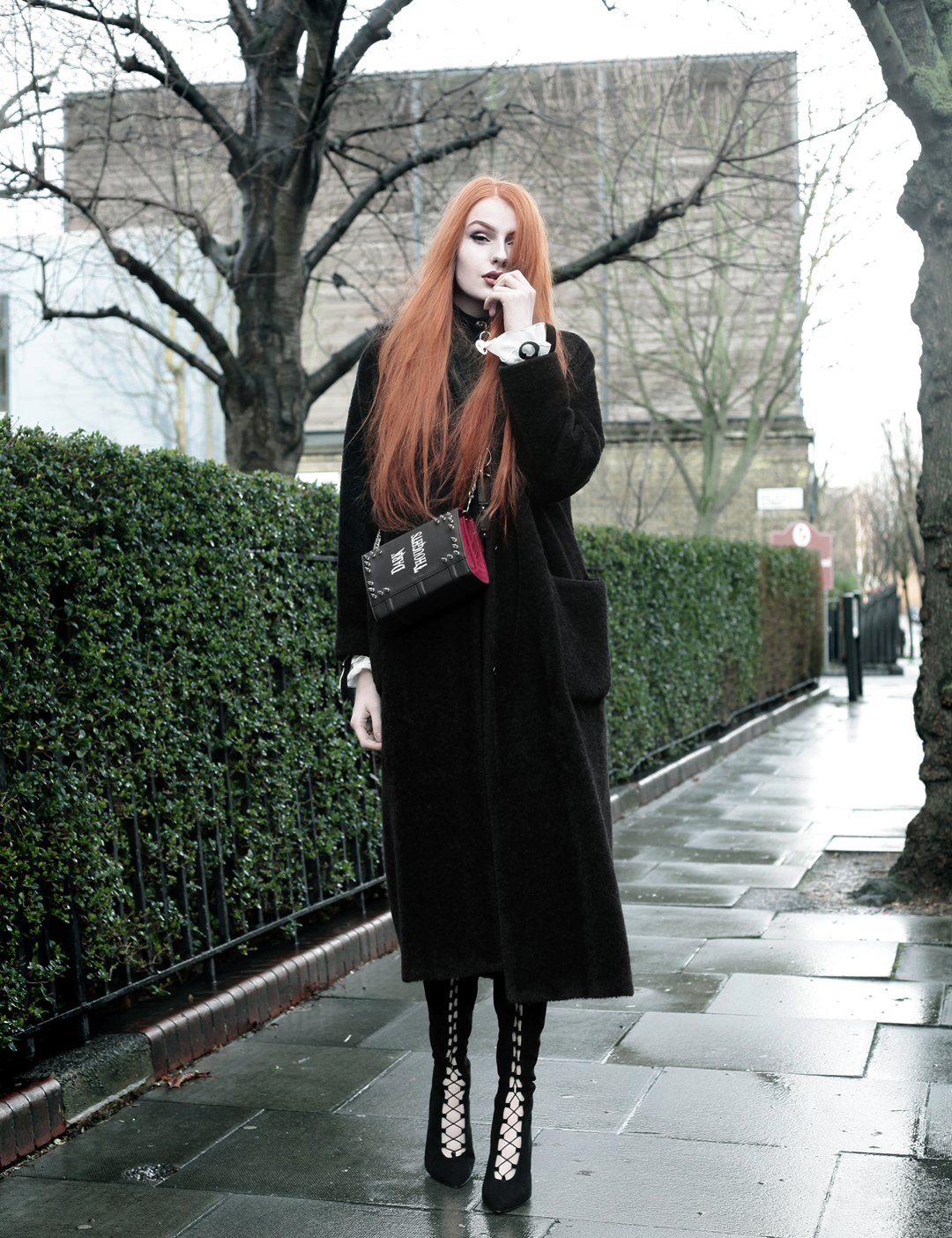 Olivia Emily wears Skinny Bags Dark Thoughts Clutch, Vintage Max Mara coat, and Asos Lace Up Boots