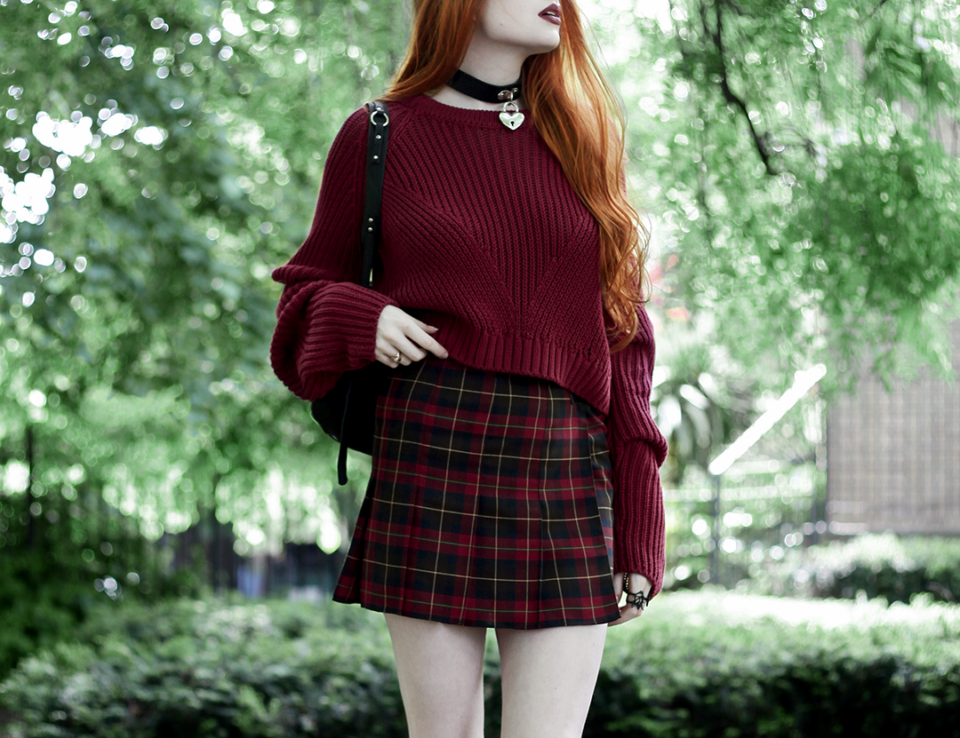 Olivia Emily wears River Island Studio Red Jumper, Topshop red plaid check skirt, Killstar Heart Choker, and Killstar Emily Heart Locket Choker