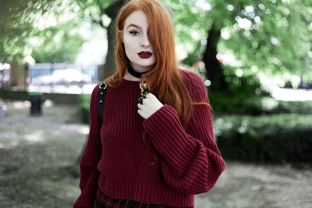 Olivia Emily wears River Island Studio Red Jumper, Killstar Heart Choker, Killstar Emily Heart Choker and Rogue and Wolf Cat Familiar ring