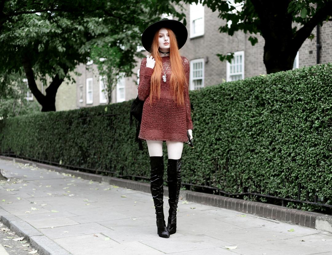 Olivia Emily wears Unif Knit Jumper, Asos Fringe Backpack, Killstar Witch Brim Hat, and Ego Velvet Over Knee Boots