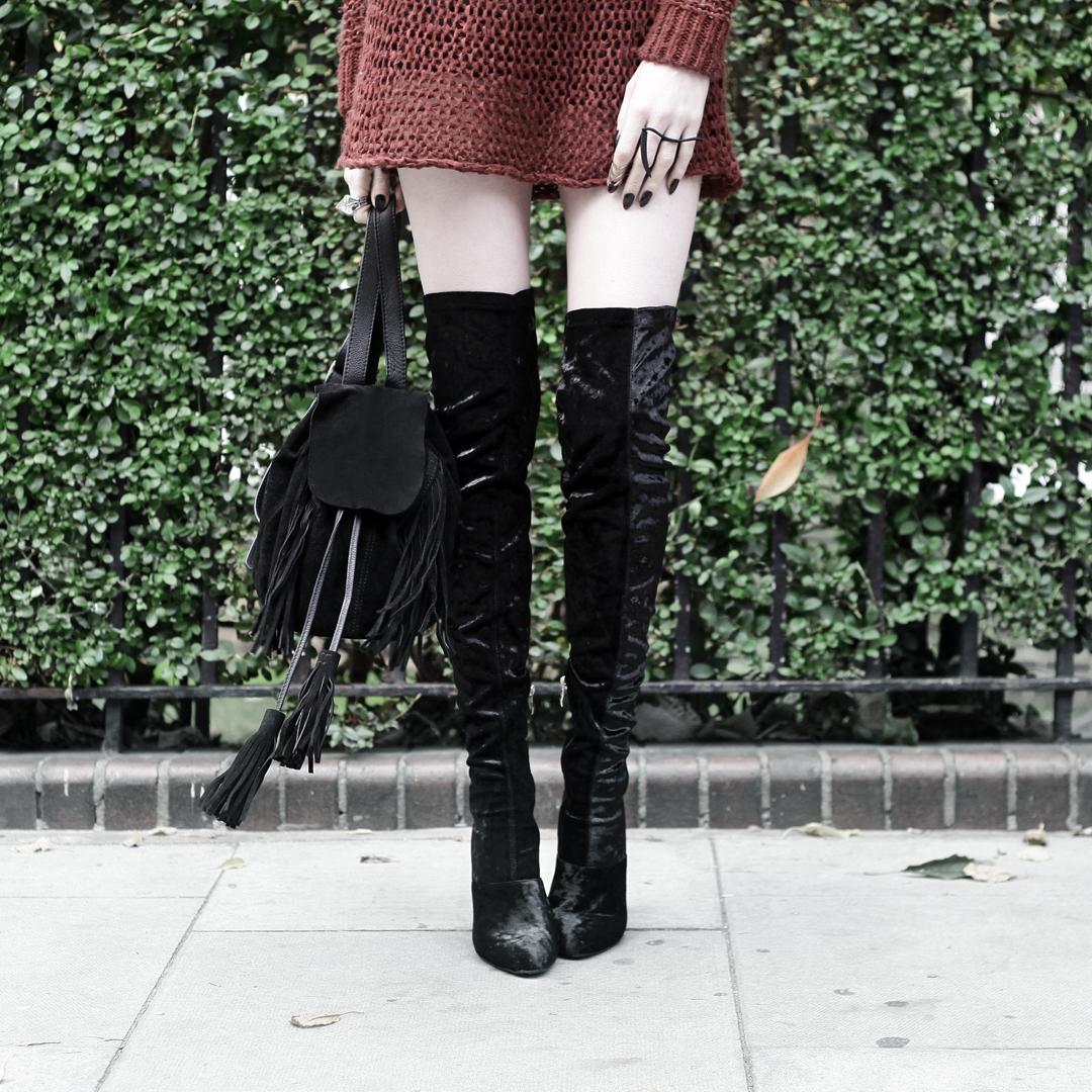 Olivia Emily wears Unif Knit Jumper, Asos Fringe Backpack, and Ego Velvet Over Knee Boots