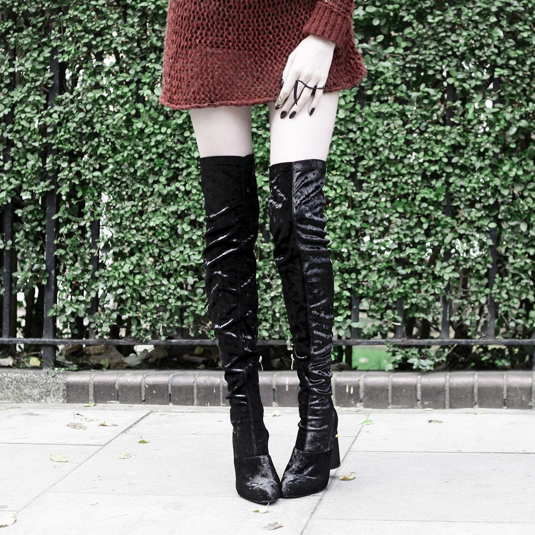Olivia Emily wears Unif Knit Jumper, Rogue and Wolf Reparer Ring, and Ego Velvet Over Knee Boots
