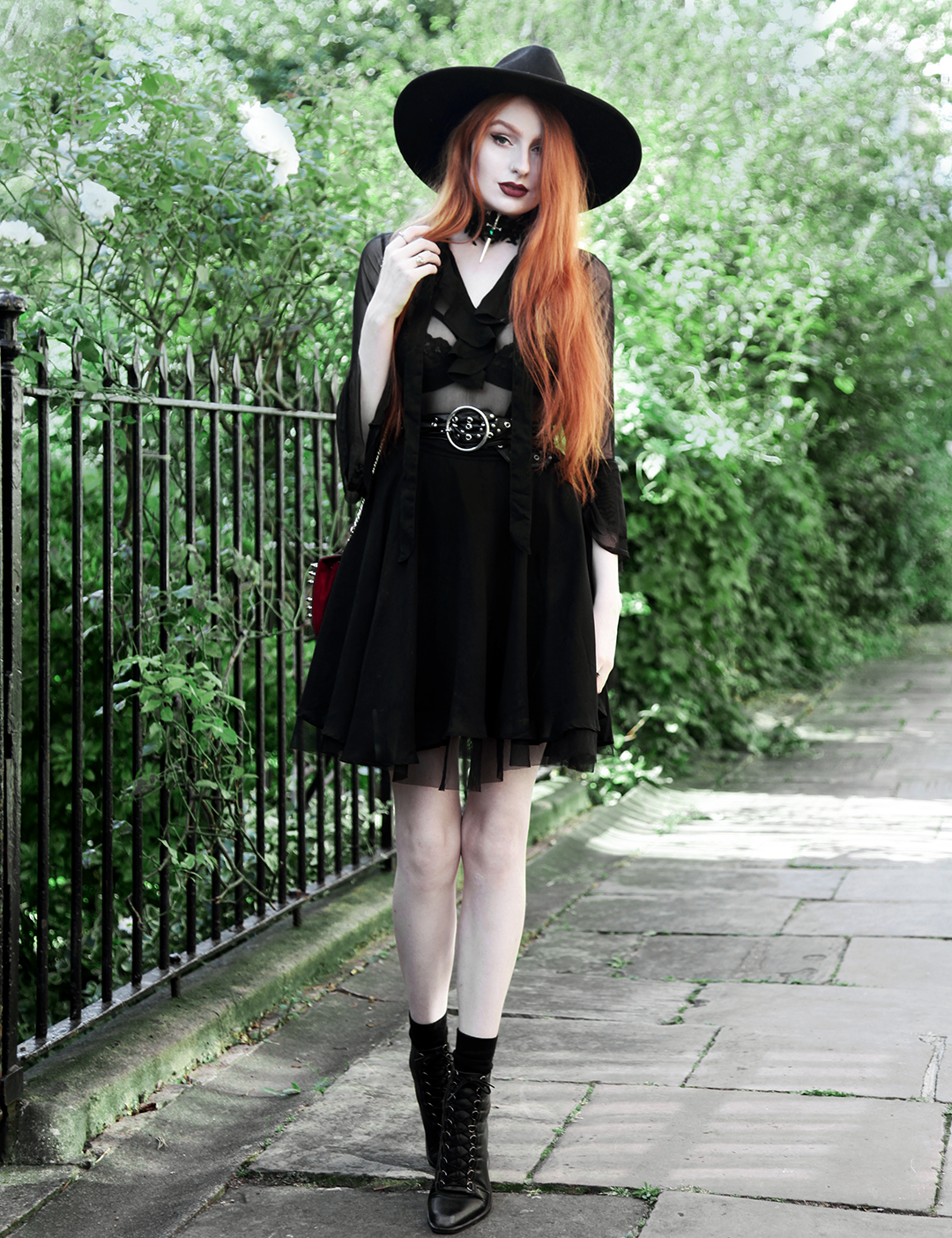 Olivia Emily wears Killstar Witch Brim Hat, Killstar Decay Nu-Mourning dress, Pheren Couture Sword Choker, Asos Eyelet Waist Belt and Asos Pointed Toe Boots