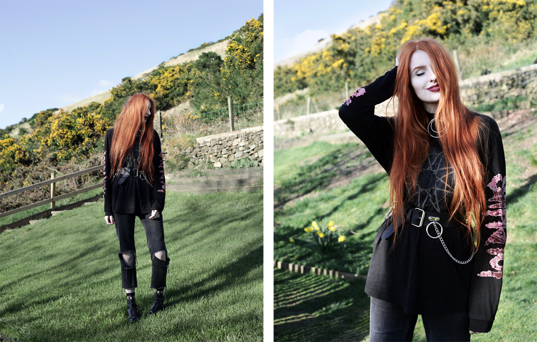 Olivia Emily wears Slipknot Band Tee, Asos ripped straight leg jeans, pothole fishnet socks, and Dr Martens boots