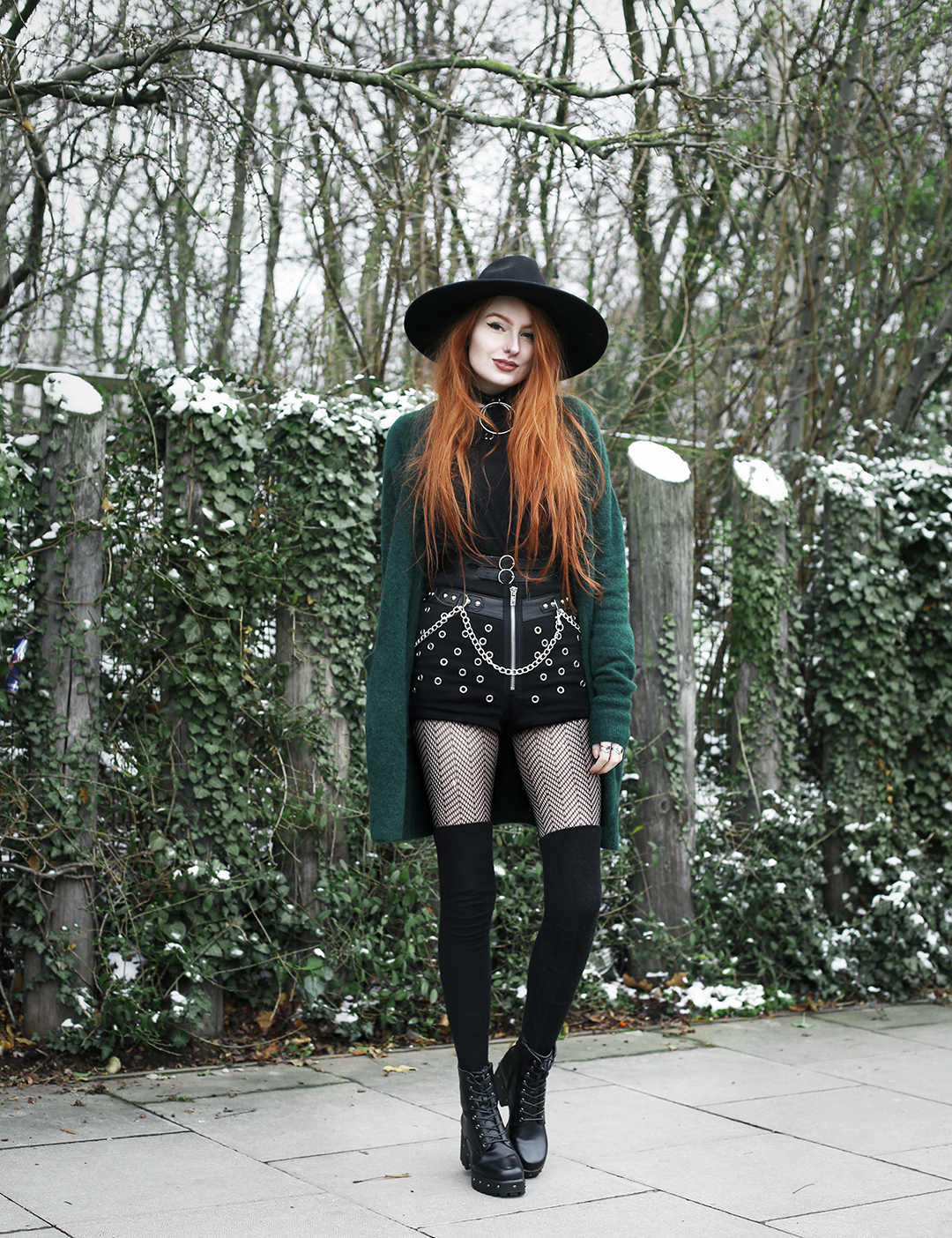 Olivia Emily styles up statement studded shorts for colder temperatures with cosy overknee socks, knitted cardigan and an oversized top