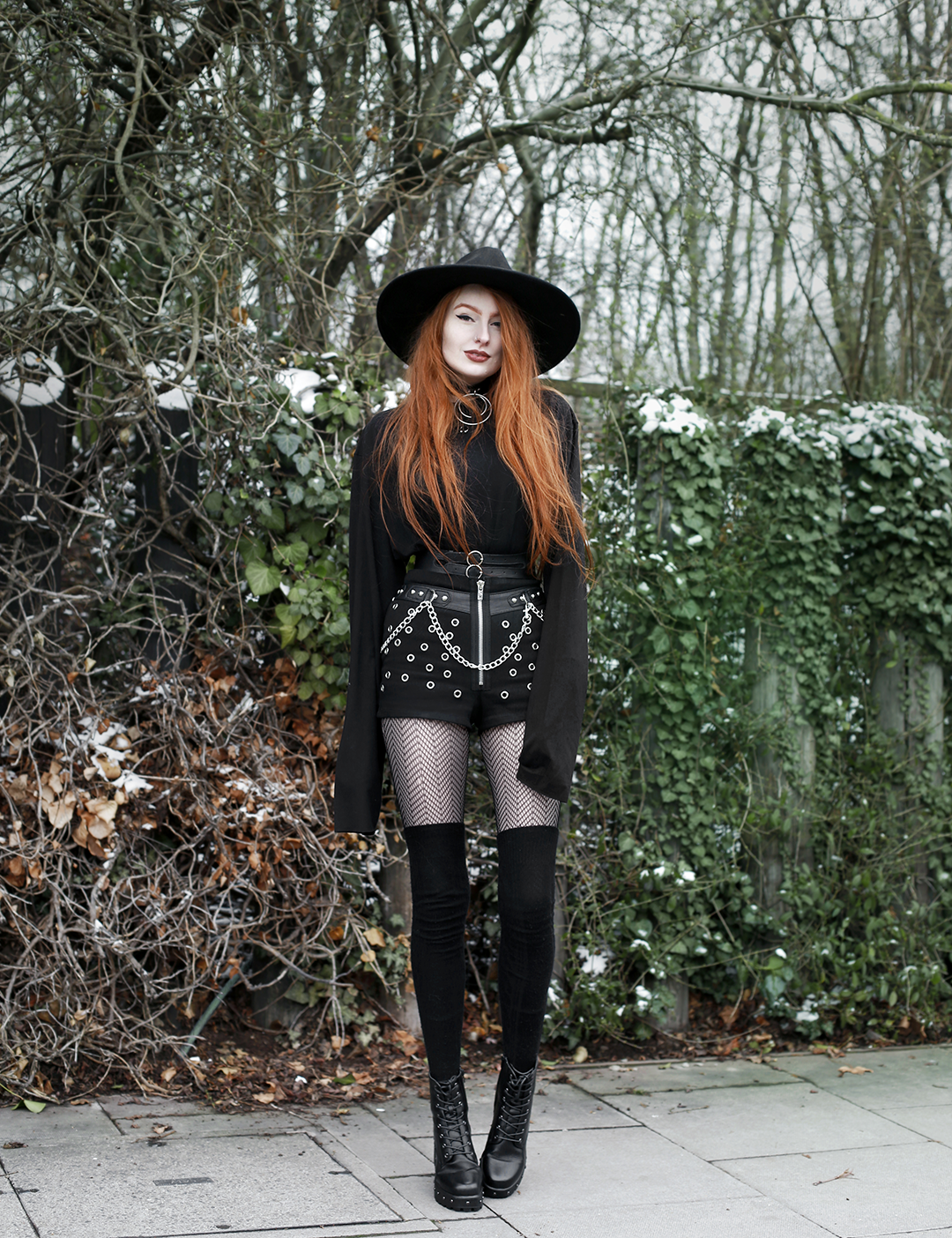 Olivia Emily styles up statement studded shorts for colder temperatures with cosy overknee socks and an oversized top
